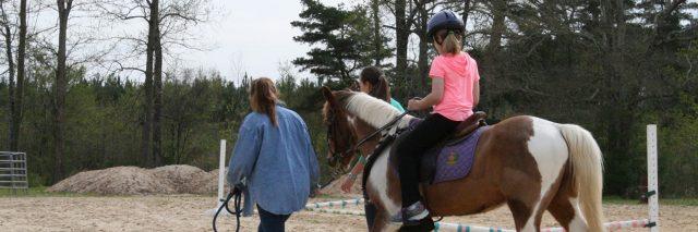 Riding a horse.