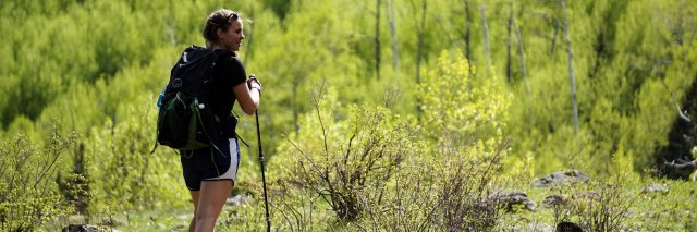 young woman in hiking gear posing on Appalachian Trail