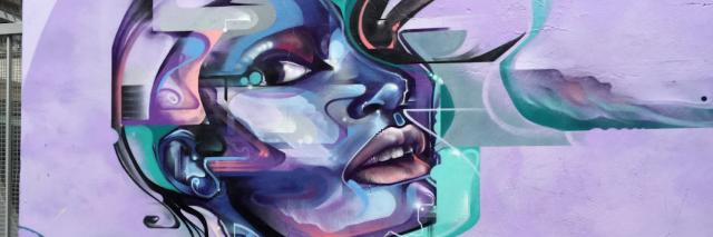 graffiti on a wall of a woman's head