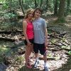 Mom and son standing together in forest setting