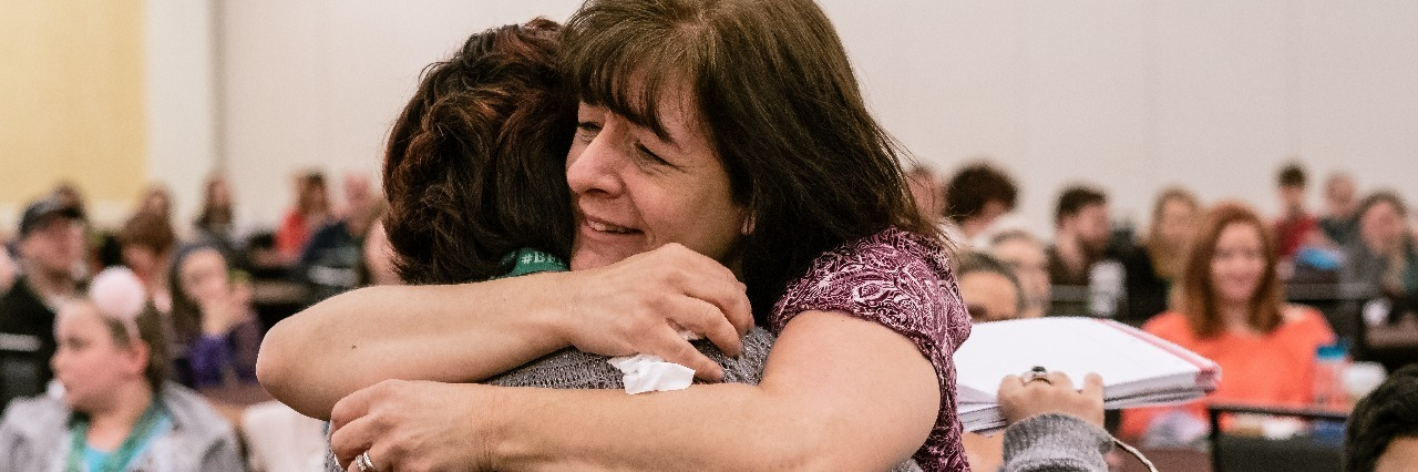 Embracing in tears, after I gave my speech at the 2017 TLC Conference - mother and daughter embracing in tears