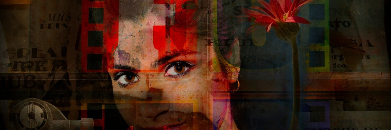 Portrait of young woman wit flower on grunge abstract background