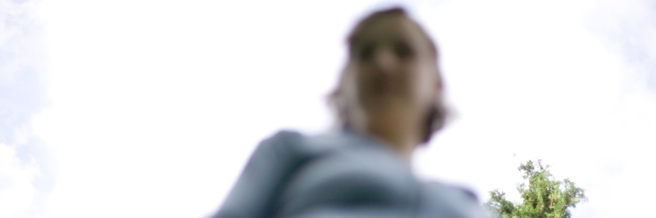 An image of a blurry woman