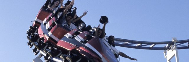 people riding on a rollercoaster