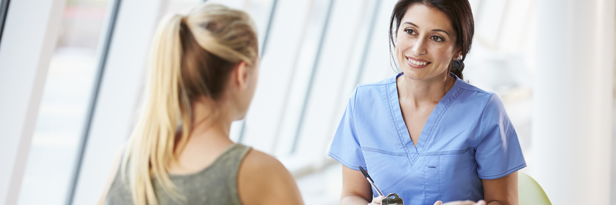 young woman talking to a nurse