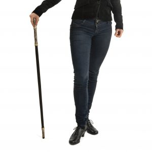 Woman with a walking stick.
