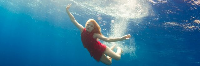 A woman swimming underwater