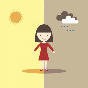 Graphic of a woman, half happy half sad
