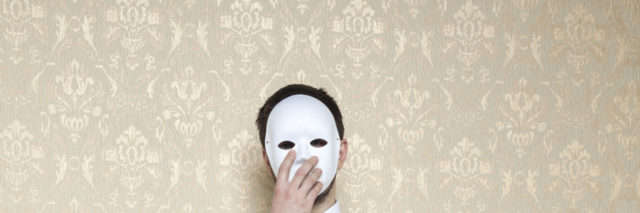 businessman hiding behind the mask