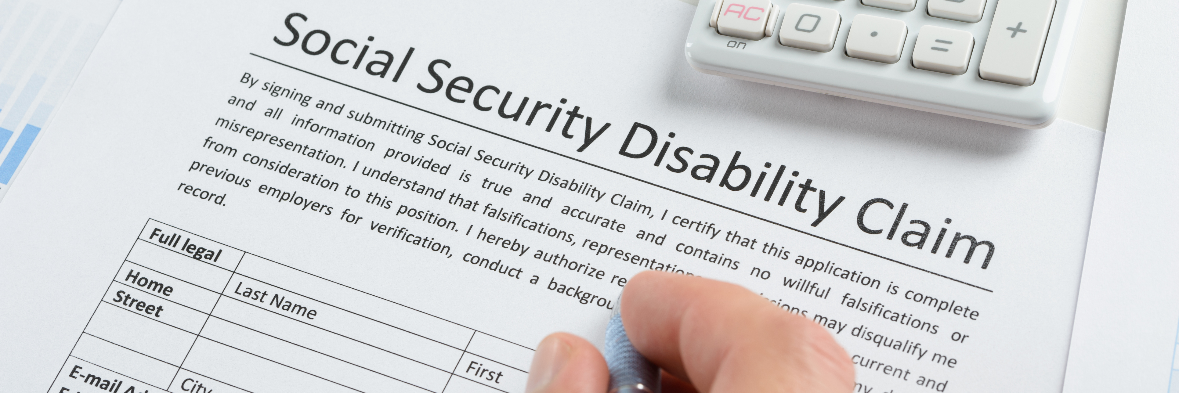 Person filling out disability form.