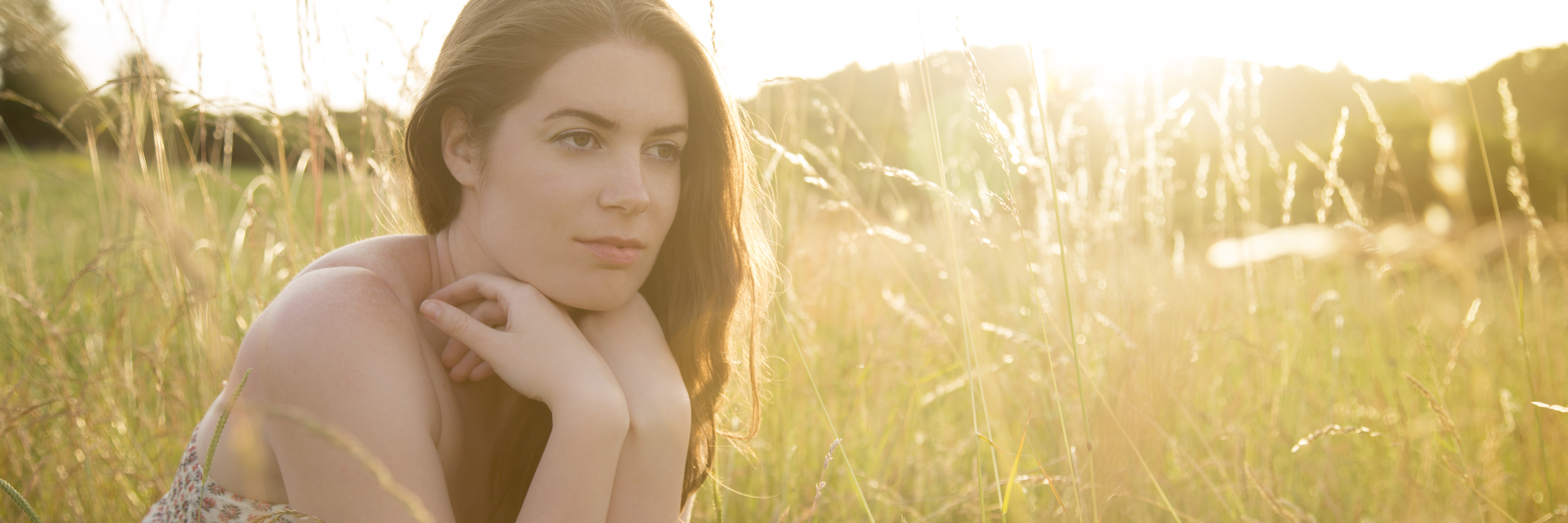 young woman in field in sunshine