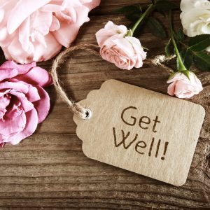 A get well soon card on flowers