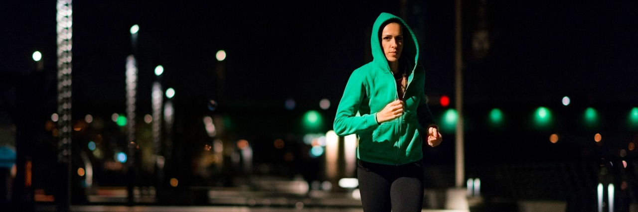 Woman jogging at night.