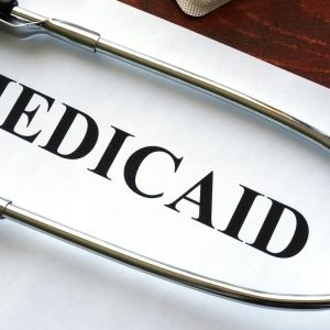 Paper that says Medicaid with a stethoscope over it