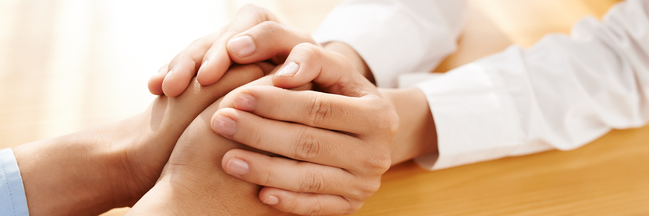 woman's hands reassuring someone