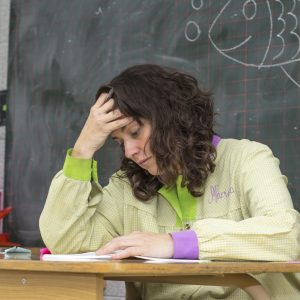 stressed tired female teacher in classroom