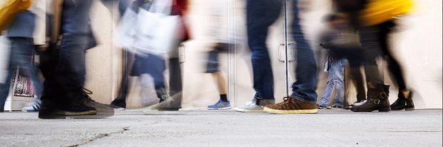 blurry people on sidewalk