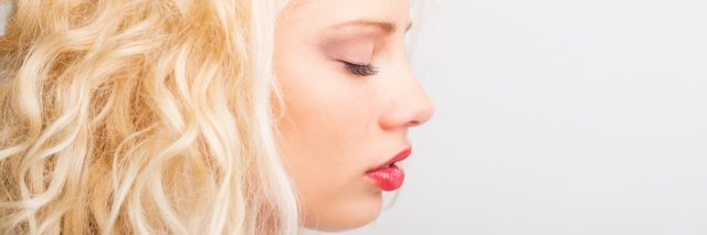 Profile photo of blonde woman with eyes closed.