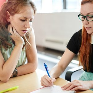 A teacher helping a student with school work
