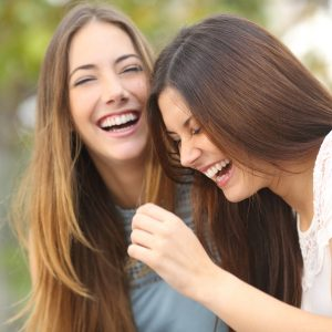 two best friends laughing together