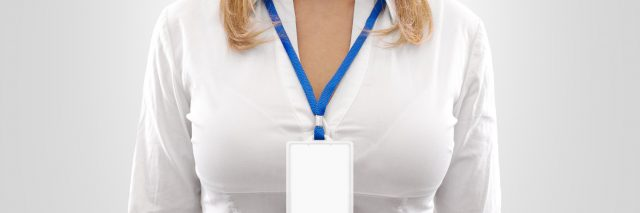 woman wearing a blank id badge around her neck