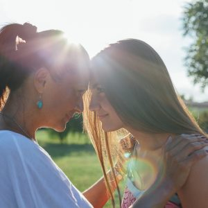 A mother and daughter embracing outside