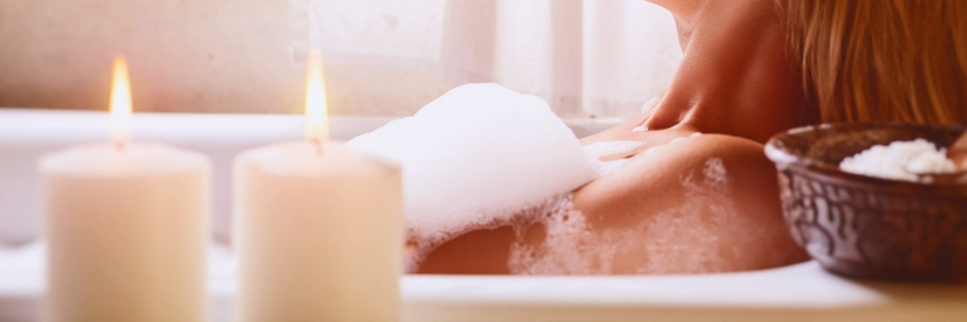 Pretty woman relaxing in bathtub, spending peaceful time in a luxury spa resort, enjoying body treatment and hygiene procedure