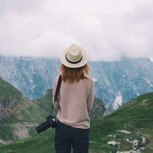 A woman standing on a mountain