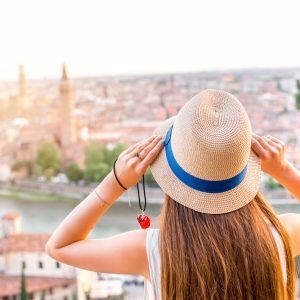 woman wearing a hat and overlooking a city