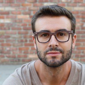 Young attractive man looking at camera