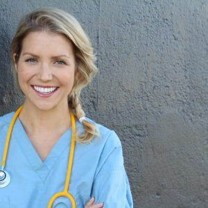 nurse smiling with stethoscope around her neck