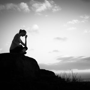 silhouette of upset woman outdoors black and white