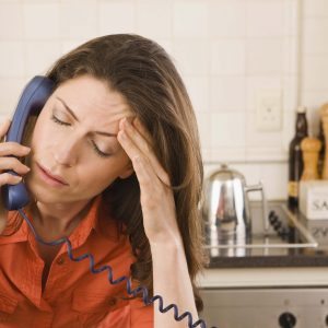 Distresses woman on the phone.