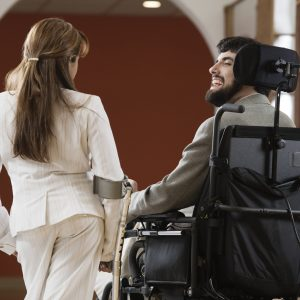 Woman and man with cerebral palsy talking.