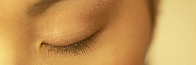 close up of woman's closed eye