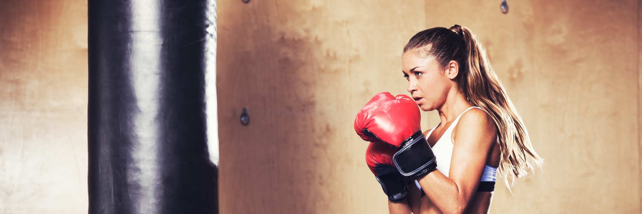 Woman wearing boxing gloves and ready to fight if she needs to.
