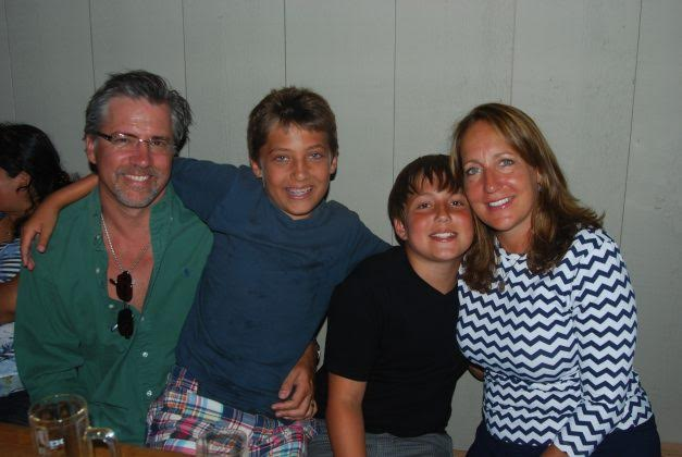 allison moore with husband and two sons