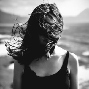 woman face covered by her hair