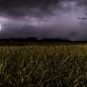 storm and lightning over fields