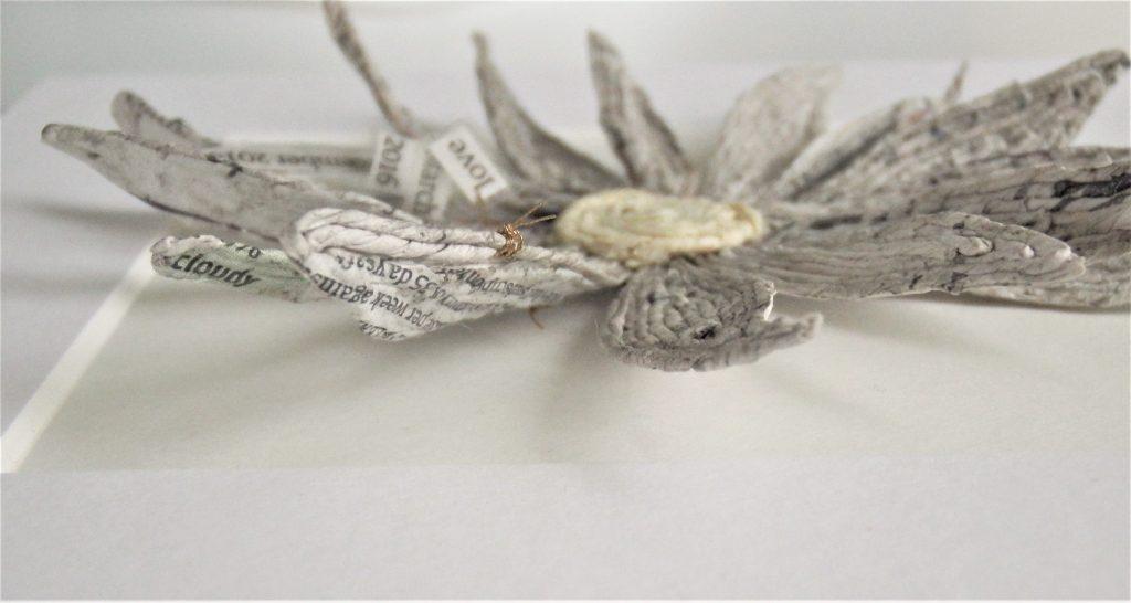 newspaper yarn design daisy from side