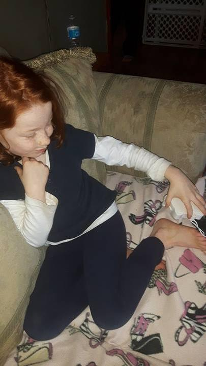 girl cooling feet with fan
