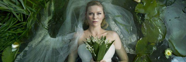melancholia image of kirsten dunst holding flowers