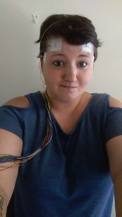 woman with wires attached to her forehead