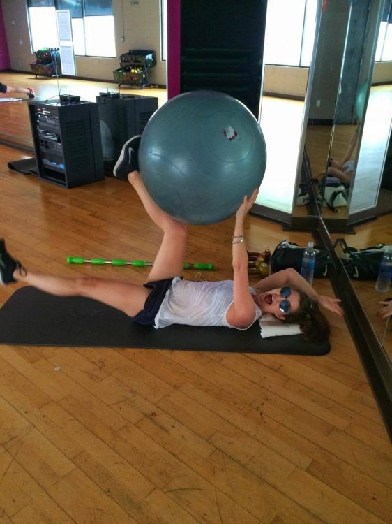 woman doing core exercises on the floor in physical therapy