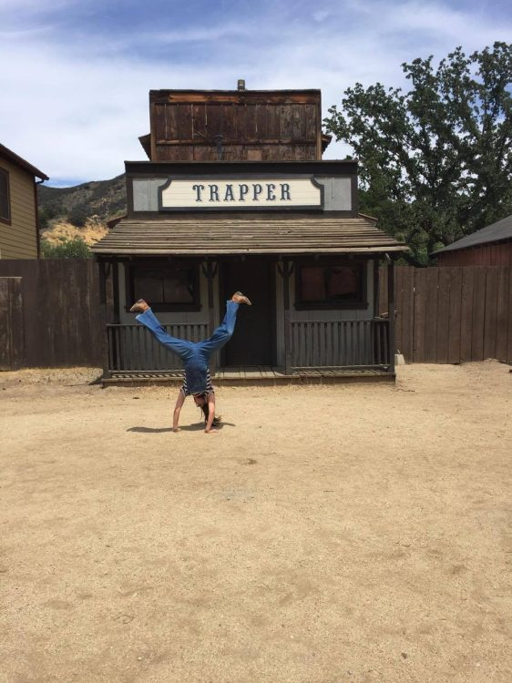woman doing cartwheels on the set of West World