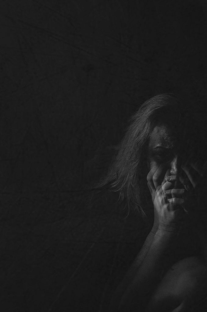 Black and white image of photographer's representation of how depression affects her hope - double exposure of woman's hands covering mouth