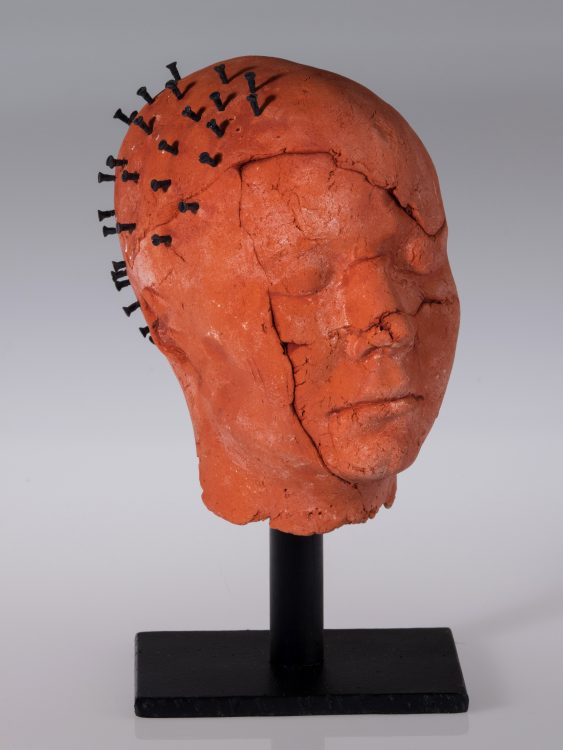 ceramic head with screws in skull