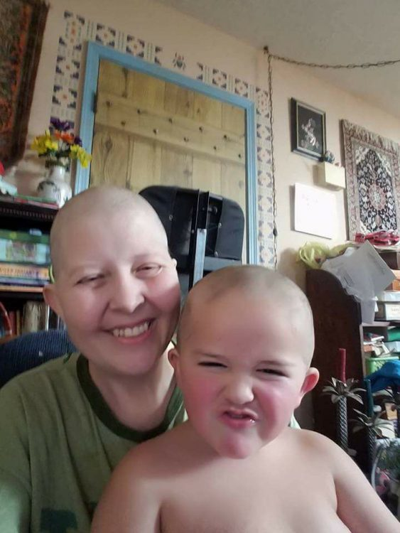 woman and son with bald, shaved heads