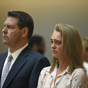 Michelle Carter and her attorney Joseph Cataldo stand to hear Judge Lawrence Moniz announce his verdict on Friday, June 16, 2017, in Bristol Juvenile Court in Taunton, Mass. Carter was found guilty of involuntary manslaughter in the suicide of Conrad Roy III. (Glenn Silva/Fairhaven Neighborhood News, Pool)