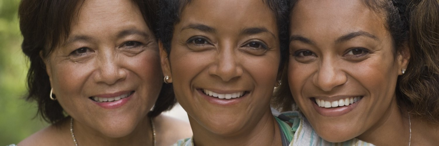 older woman and two younger women smiling